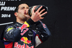 Daniel Ricciardo, Red Bull Racing celebrates his third position with the champagne on the podium