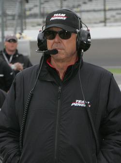 Rick Mears looks on
