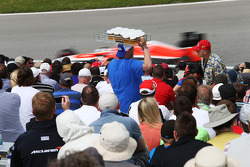 Fans enjoy lager in the grandstands