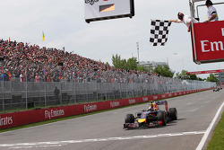 Race winner Daniel Ricciardo, Red Bull Racing RB10 takes the chequered flag at the end of the race