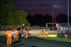 Fernando Rees out of the car following his crash in the Porsche curves Wednesday during qualifying