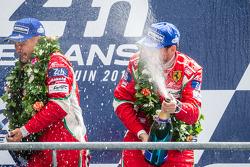 LMGTE Pro podium: class winners Toni Vilander, Giancarlo Fisichella spray champagne