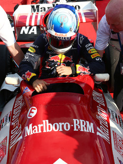 Sebastian Vettel, Red Bull Racing with the BRM P160 once driven by Dr Helmut Marko, Red Bull Motorsport Consultant