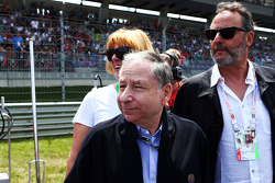 Jean Todt, FIA President with Jean Reno, Actor on the grid