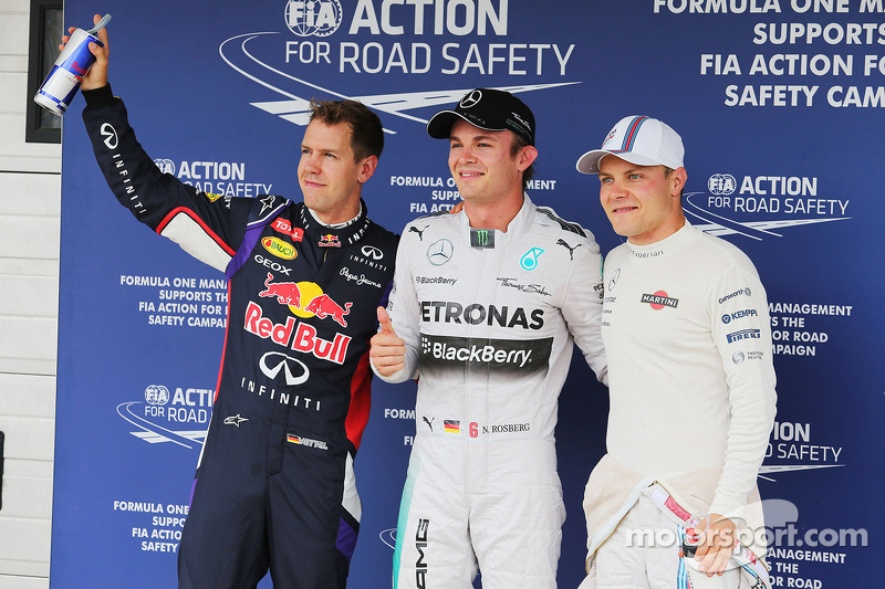 Qualifying top three in parc ferme Sebastian Vettel, Nico Rosberg and Valtteri Bottas