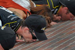 Race winner Jeff Gordon kisses the yard of Bricks
