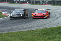 Anthony Lazzaro, Ferrari 458 GT3 and Andy Pilgrim, Cadillac CTS-V.R fight through turn 4