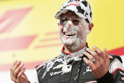 Race winner Will Power gets a face full of cream puff