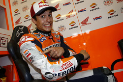 Marc Marquez, Repsol Honda Team shows off the scraped suit after nearly falling off