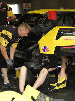 Corvette crew members repair the #3 Corvette