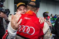 Race winner and Blancpain Endurance Series champion Laurens Vanthoor celebrates with Christopher Mies