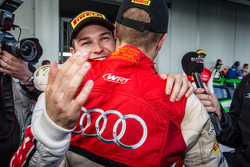 Race winner and Blancpain Endurance Series champion Laurens Vanthoor celebrates with Christopher Mies