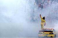 Joey Logano celebrates