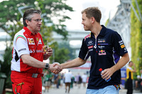 Pat Fry, Ferrari Deputy Technical Director and Head of Race Engineering with Sebastian Vettel, Red Bull Racing