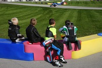 Young drivers watch their racing idols on track