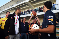 Christian Horner, Red Bull Racing Team Principal, practices his basketball skills with Tony Parker, NBA Basketball Player, and Daniel Ricciardo, Red Bull Racing