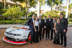 NASCAR Nationwide Series champion owner Roger Penske poses with drivers Brad Keselowski, Ryan Blaney, Michael McDowell, Alex Tagliani and Joey Logano