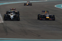 Kevin Magnussen, McLaren MP4-29 and Daniel Ricciardo, Red Bull Racing RB10 battle for position