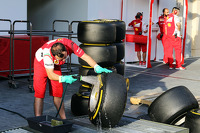 Ferrari mechanic washes Pirelli tyres