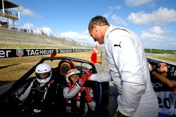 Winner Tom Kristensen is congratulated by second place David Coulthard