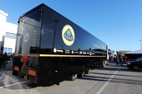 A Lotus F1 Team truck arrives in the paddock