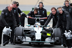 Lewis Hamilton, Mercedes AMG F1 W06 is pushed down the pit lane by mechanics after he stopped