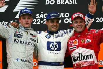 Podium: race winner Juan Pablo Montoya with Kimi Raikkonen and Rubens Barrichello