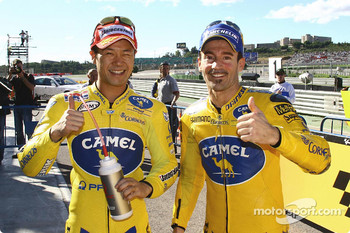 Front row for the Valencia GP: pole winner Makoto Tamada celebrates with Max Biaggi