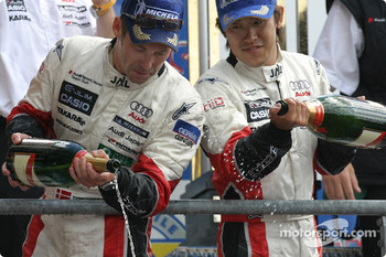 LM P1 podium: Seiji Ara and Tom Kristensen pour some champagne