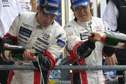 LM P1 podium: Seiji Ara and Tom Kristensen pour some champagne