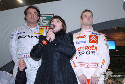 The Nations Cup 2004 winners Jean Alesi and Sébastien Loeb of Team France 1, with French singer Mireille Mathieu performing the National Anthem