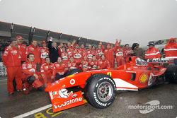 Andrea Bertolini, Team Ferrari crew members, Lapo Elkann and Alfredo Cazzola pose