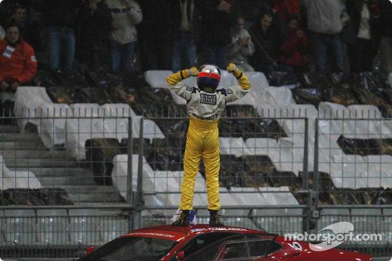 The Race of Champions 2004 winner Heikki Kovalainen celebrates