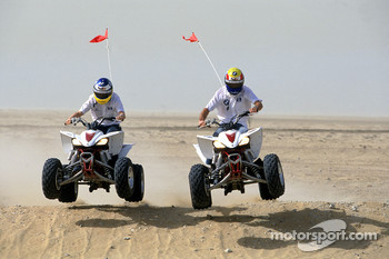 Mark Webber and Nick Heidfeld on quad bikes