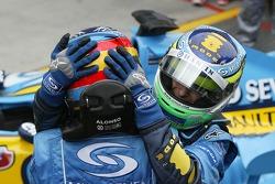 Race winner Giancarlo Fisichella celebrates with Fernando Alonso