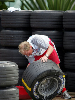 Toyota team member prepares tires