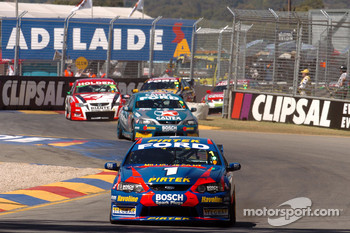 Marco Ambrose and Russell Ingall passed Rick Kelly before Turn One