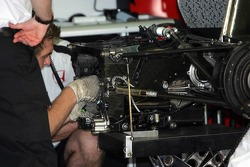 BAR-Honda team members repair gearbox on Takuma Sato's car