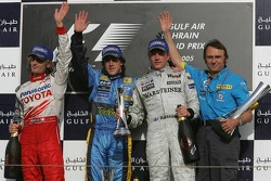 Podium: race winner Fernando Alonso with Jarno Trulli, Kimi Raikkonen and Denis Chevrier