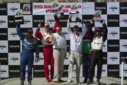 Podium: race winner Sébastien Bourdais with team owners Paul Newman and Carl Haas, and Paul Tracy and Bruno Junqueira