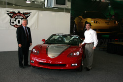 Rick Scheidt, Chevrolet executive director for product and brand development, and Joie Chitwood, IMS president and chief operating officer, with the Chevrolet Corvette Convertible that will pace the 89th Indianapolis 500 with General Colin Powell behind t