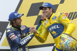 Podium: race winner Alex Barros with Valentino Rossi