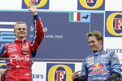 Podium: race winner Heikki Kovalainen with Scott Speed