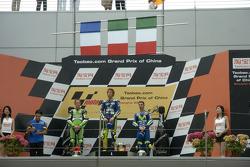 Podium: race winner Valentino Rossi celebrates