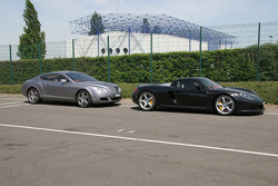 Porsche Carrera GT and Bentley in the paddock