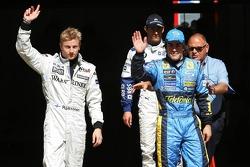 Pole winner Kimi Raikkonen celebrates with Fernando Alonso