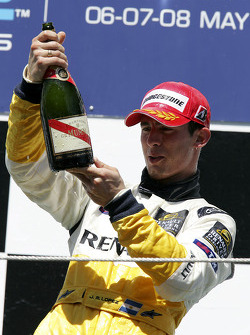 Podium: Jose Maria Lopez checks the age of the champagne