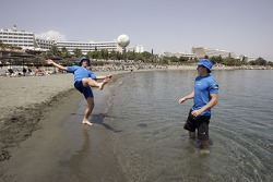 Petter Solberg and Chris Atkinson play football on the beach in Limassol