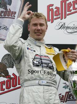 Podium: race winner Mika Hakkinen celebrates