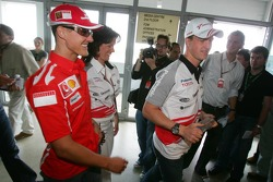 Michael Schumacher and Ralf Schumacher come out of the FIA press conference